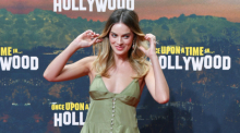 Schauspielerin Margot Robbie kommt zur Premiere des Films «Once Upon a Time... in Hollywood» in das Kino Cinestar. Foto: Jens Kalaene/Dpa-zentralbild/dpa