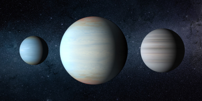 This is an artistic rendition of the Kepler-47 circumbinary planet system. The three planets with the large middle planet being the newly discovered Kepler47d. Foto: NASA/Jplcaltech/T. Pyle